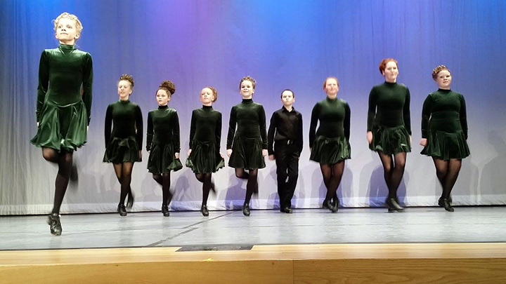 Nine dancers in green and blackPhoto by A. Maloney